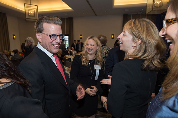 27th Awards Luncheon Lowell Milken, chairman and co-founder of the Milken Family Foundation, greets 2016 Jewish Educator Award recipient Ilana Ribak (center) and Dr. Sarah Shulkind, head of school at Sinai Akiba Academy in Los Angeles.