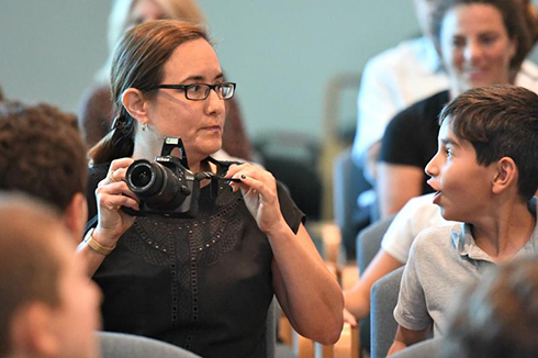 Adrienne Coffield Notification Camera in hand, Adrienne Coffield is ready to snap a photo of the newest Jewish Educator Award recipient...but when the winner's name is called, she realizes she's the one in the spotlight today!