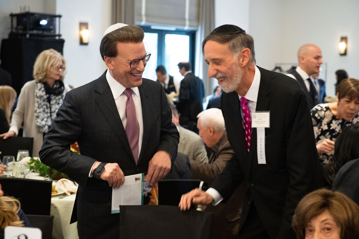 30th Awards Luncheon Lowell Milken, chairman and co-founder of the Milken Family Foundation, visits with 2019 Jewish Educator Award recipient Rabbi Abraham Lieberman.