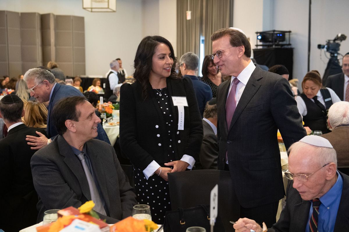 30th Awards Luncheon 2019 Jewish Educator Award recipient Nelly Wisner talks with Lowell Milken, chairman and co-founder of the Milken Family Foundation, as guests find their seats.